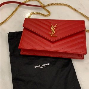 YSL red and gold wallet on a chain.